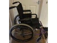 Small purple and black wheelchair