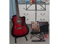 BRAND NEW VINTAGE MAKE VEC500RB ELECTRO ACOUSTIC GUITAR WITH AMP, STAND,CAPO AND LOADS OF EXTRAS.