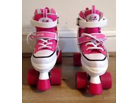 Girls roller skates, size 2-5, hardly used, almost as new!