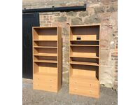 Two solid shelf units