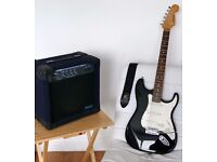 Electric Guitar and amplifier - Black, Stratocaster style with strap. Ideal for beginners!