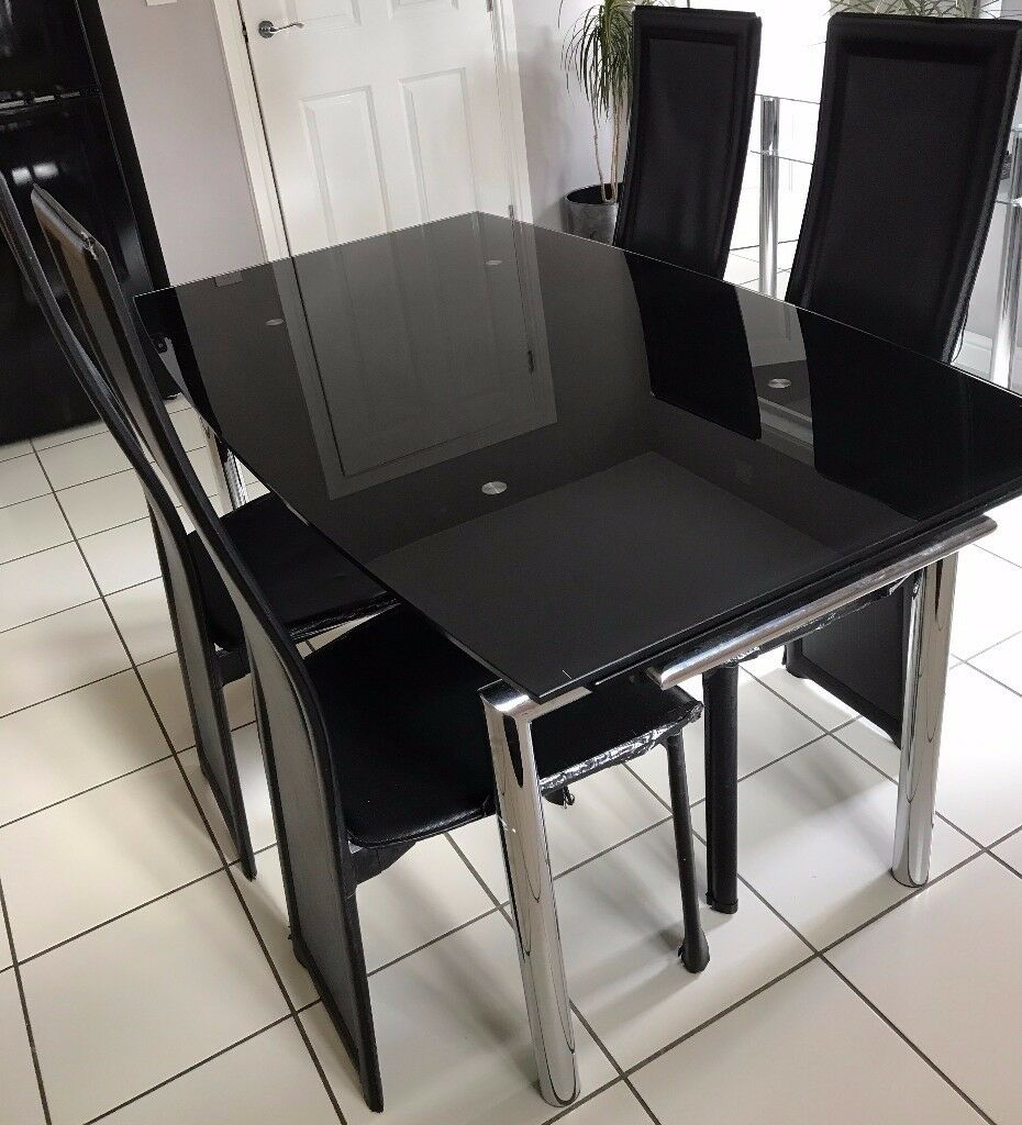 - SOLD- House clearance: Black glass Extending Dining table and 4 Black Chairs