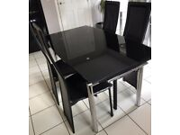 House clearance: Black glass Extending Dining table and 4 Black Chairs