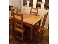 Solid oak extending dining table with 4 solid oak chairs