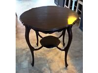 Elegant Edwardian mahogany occasional table.