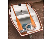 Glassfibre dinghy 2M long, gunwale rubbers, folding wheels, built in buoyancy, oars, anchor and rope