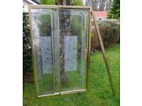 Gold pivot shower door – Celtic design