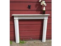Wooden hand painted fire surround, distressed wax finish.
