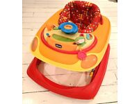 Baby Walker Chicco Brand. Adjustable height. Folds down for easy storage. Used but good condition