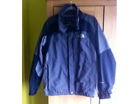 Men's North Face outer waterproof jacket. Size Medium.