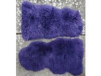 A Pair of Real Sheepskin Rugs in dark Mauve