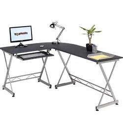 Black slim line corner desk chair monitor Ikea cabinet