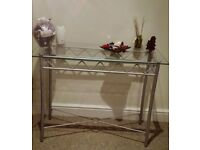 A stylish chrome and glass console hallway table