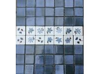 "Blue square mosaic kitchen tiles (75mm/3"") with flower inserts."