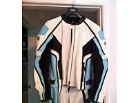 Hein Gericke Ladies blue white and black motorbike jacket and trousers as new. jacket 16 trouse 14.
