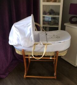 Moses basket and stand. Excellent condition and practically brand new.