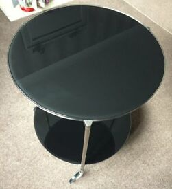 Black Glass and Chrome Occasional Table on wheels