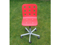 red swivel office / work chair .