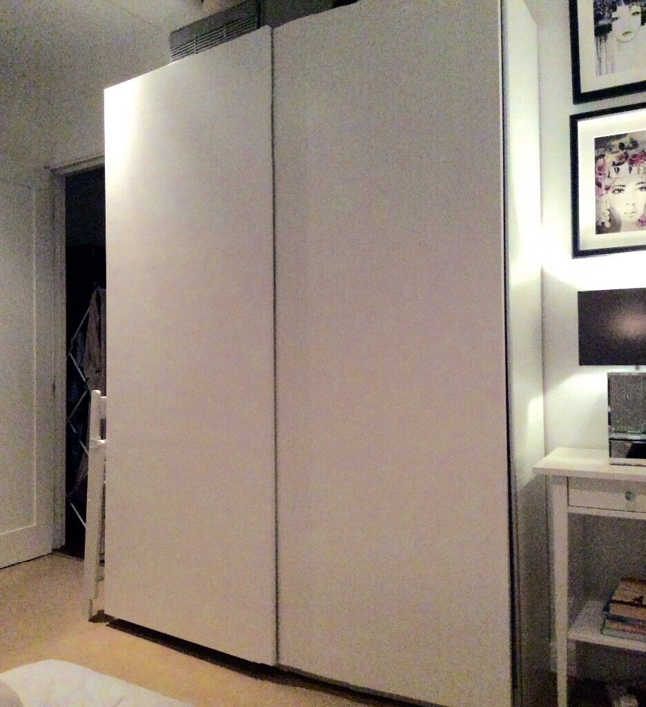 ikea pax double wardrobe sliding doors white in. Black Bedroom Furniture Sets. Home Design Ideas