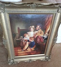 oil painting in ornate gold frame of a victorian family