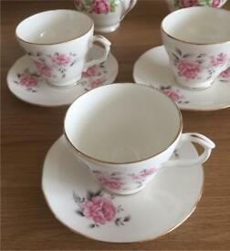 ThreeEnglish bone china cups and saucers