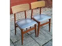 two retro dining chairs. In clean condition.