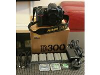 Nikon D300 body + Nikkor 18-55mm VR + plus some extras