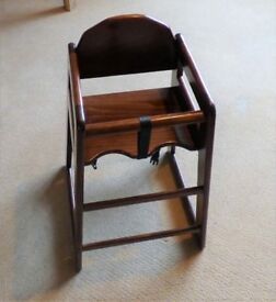Child's high chair, dark wood with straps