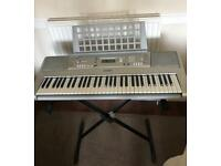 **ITEM SOLD** YAMAHA PSR-E303 61-Key Electronic Keyboard with power adapter and music stand.