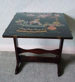 SMALL FOLDING VINTAGE OAK TABLE TILTS TO FOLD FLAT WITH EMBROIDERY SEWN PICTURE