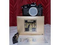 Nikon FM2n black 35mm film camera brand new unused boxed the lot very Iconic.
