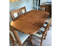Extendable dining table six chairs, sideboard and cabinet