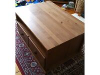 Wood coffee table with two drawers and several open storage compartments