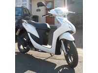 Honda Vision 49cc. One owner. Superb cond/always garaged. Low ins/tax. Fuel £5/100miles. Rev and go!