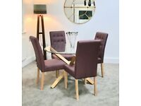 Glass topped dining table and 4 plum upholstered chairs