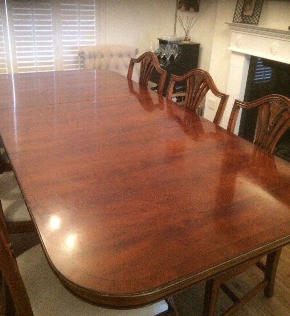 Yew wood dinning table and 8 chairs