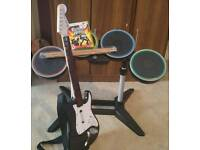 Xbox 360 Guitar hero drum kit+brand new sticks+guitar and a game