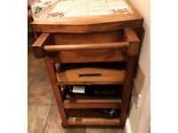 Solid wood island with ceramic tile top, storage & wine rack. Used but excellent condition