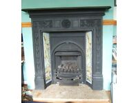 Black victorian fireplace with side panel tiles depicting birds and reeds.