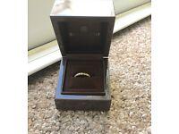 18 carat gold diamond eternity ring size M from Beaverbrooks