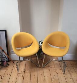 Four cantilevered chrome framed chairs