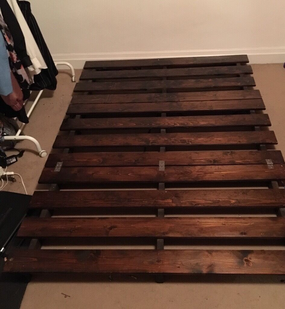 Dark wood Futon for sale.