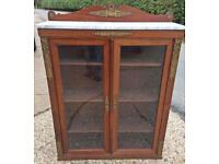 Mahogany display cabinet with marble top