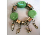 green glass and charm bracelet