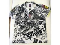 4 brand new authentic Ed Hardy men's designer polo shirts. Cotton material with rhinestones