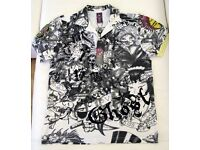 4 brand new Ed Hardy men's designer polo shirts. All are size Medium.