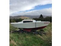 14ft boat with small cabin and trailer