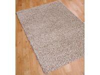 A set of 3 beige rugs