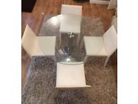 Glass top table and four leather chairs