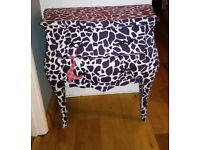 bombe style french commode upholstered in funky animal print
